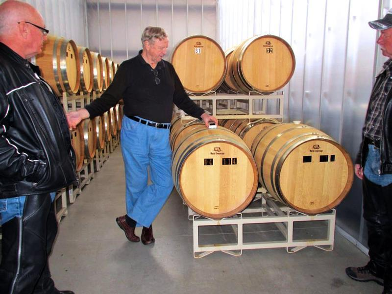 Peter showing barrels of Run to visitors